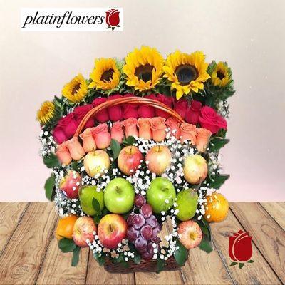 canasta girasoles frutas rosas