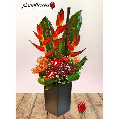 elegante base flores exoticas